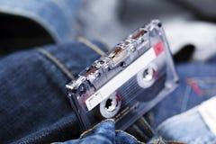 Магнитофонная кассета на джинсовой ткани Стоковые Изображения