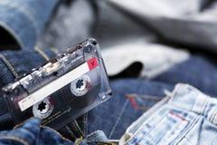 Магнитофонная кассета на джинсовой ткани Стоковое Изображение