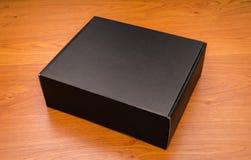 Пустая насмешка черного ящика вверх на деревянной предпосылке Стоковые Фотографии RF