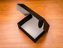 Пустая насмешка черного ящика вверх на деревянной предпосылке Стоковые Изображения RF
