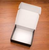 Пустая насмешка черного ящика вверх на деревянной предпосылке Стоковое Фото