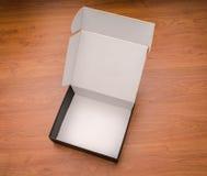 Пустая насмешка черного ящика вверх на деревянной предпосылке Стоковая Фотография