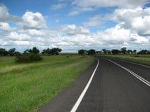 Пустая дорога захолустья  Стоковые Фотографии RF