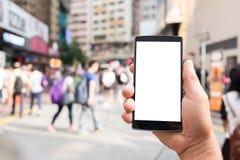 Пустая предпосылка нерезкости мобильного телефона и людей Tecnology Стоковая Фотография