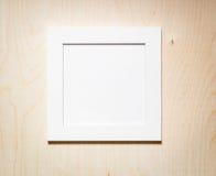 Пустая рамка фото на деревянной предпосылке Стоковое Изображение