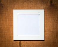 Пустая рамка фото на деревянной предпосылке Стоковая Фотография