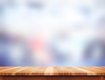 Пустая светлая деревянная столешница с предпосылкой конспекта нерезкости, разрешением Стоковое Фото
