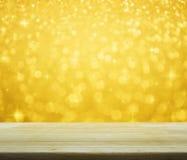 Пустая таблица над светом с сияющее звёздным, ба нерезкости золота рождества Стоковое Фото