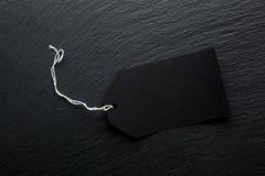 Пустая черная предпосылка бирки продажи стоковая фотография rf
