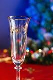 Пустое стекло Шампани на таблице Нового Года Стоковое Фото