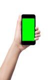 пустое удерживание руки изолировало белизну экрана мобильного телефона франтовскую Стоковые Изображения RF