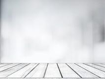Пустой белый деревянный стол с запачканной предпосылкой света bokeh магазина для дисплея продукта Стоковая Фотография