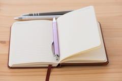 Пустой буклет с ручкой Стоковое фото RF