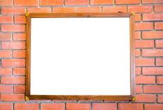 Пустой деревянный знак на кирпичной стене Стоковая Фотография RF