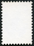 Пустой лист штемпеля почтового сбора на черной предпосылке стоковое фото