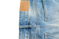 Пустой кожаный ярлык и задние карманные джинсы джинсовой ткани Стоковые Фотографии RF
