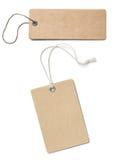Пустой коричневый изолированный комплект ценников или ярлыков картона Стоковое Изображение RF
