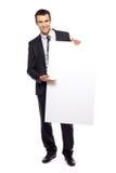 пустой плакат удерживания бизнесмена Стоковое Фото