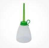 Пустой пластичный смазчик изолированный на белой предпосылке Стоковая Фотография