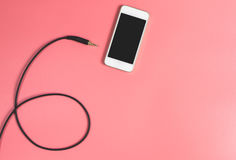 Пустой smartphone с кабелем jack Стоковые Изображения RF