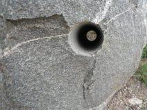 Пустотелое сверло в утесе Стоковое Фото