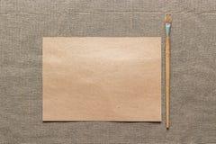 Пустые бумага и paintbrush Стоковые Изображения