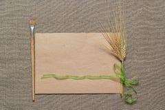 Пустые бумага, paintbrush и колоски Стоковая Фотография RF