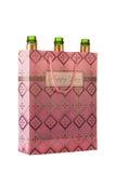 Пустые бутылки шампанского в сумке с счастливым сочинительством дня Стоковое Изображение RF