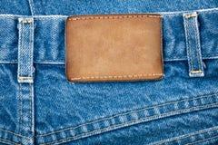 пустые джинсыы обозначают кожаное реальное стоковые фото