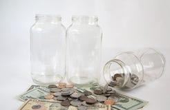 Пустые опарникы и деньги стекла Стоковое Изображение RF