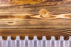 Пустые пластичные бутылки на деревянной предпосылке планок Стоковая Фотография RF