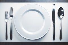 Пустые плита и столовый прибор Стоковое фото RF