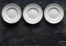 Пустые плиты на черной керамической предпосылке Стоковое Изображение