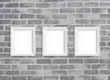 Пустые рамки на серой стене birck Стоковое Изображение