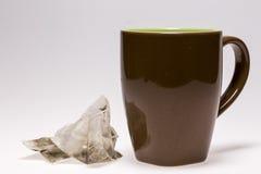 Пустые чашка и пакетик чая Стоковая Фотография
