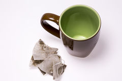 Пустые чашка и пакетик чая Стоковые Изображения