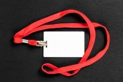 Пустые ID/значок карточки с оранжевым поясом на черной предпосылке стоковые изображения rf