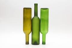 3 пустых бутылки вина на белой предпосылке Стоковое Изображение