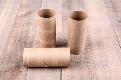 3 пустых крена туалетной бумаги Стоковые Изображения