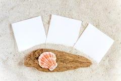 3 пустых немедленных изображения в песке Стоковая Фотография