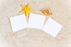 3 пустых немедленных изображения в песке Стоковые Фото