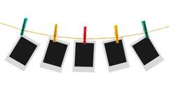 5 пустых немедленных фото на веревке для белья Стоковое Изображение RF