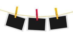 3 пустых немедленных фото на веревке для белья Стоковое Изображение RF