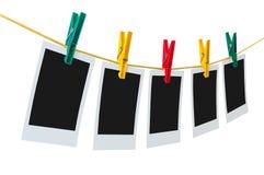 5 пустых немедленных фото на веревке для белья Стоковое фото RF