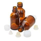 3 пустых открытых янтарных стеклянных бутылки фармации Стоковые Изображения RF