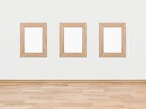 Пустые деревянные рамки на белой стене Стоковая Фотография RF