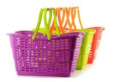 3 пустых пластичных корзины для товаров на белизне Стоковые Изображения RF