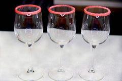 3 пустых стекла с окаймлять сахара Стоковая Фотография
