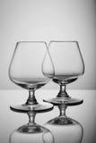 2 пустых стекла рябиновки на белой предпосылке Стоковая Фотография