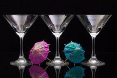 3 пустых стекла шампанского с бумажными зонтиками Стоковые Изображения RF